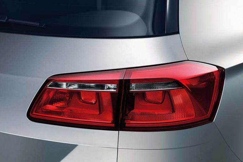 Rear brake-light shot of a silver Volkswagen Golf.