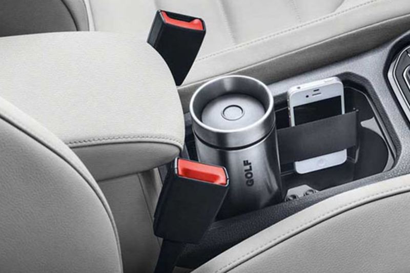 Cup and phone compartments, shown inside a Volkswagen Golf.