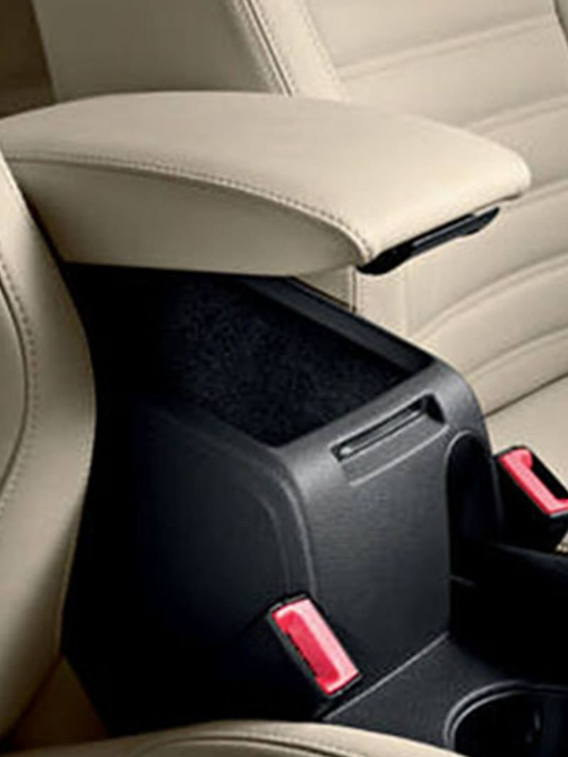 Storage compartment/arm rest between the front driver and passenger seats, inside a Volkswagen Jetta.