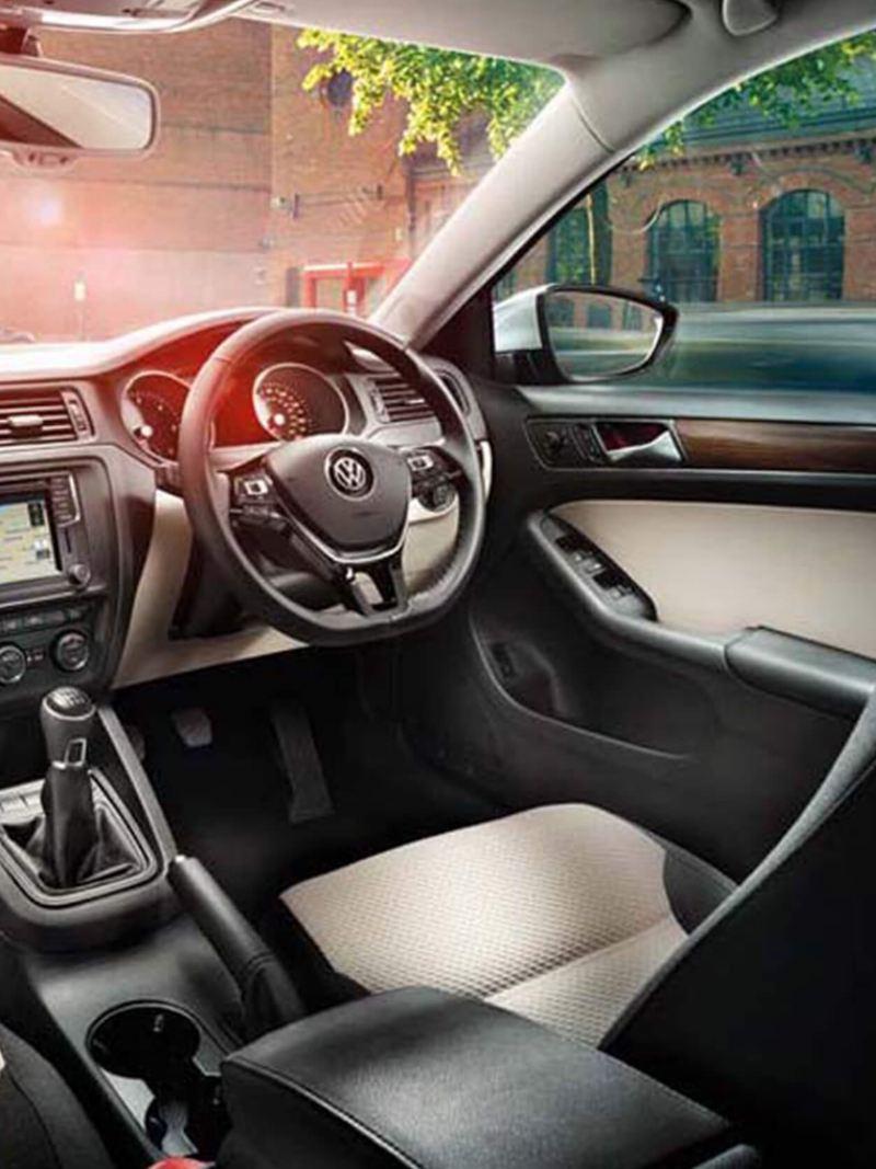 Interior shot of a Volkswagen Jetta, steering wheel and dashboard.