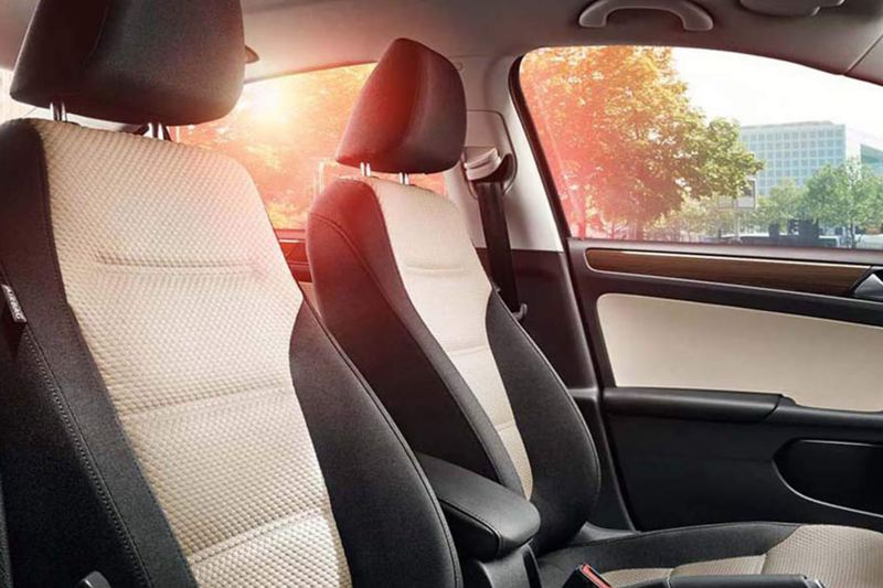 Interior shot of the front seats in a Volkswagen Jetta.