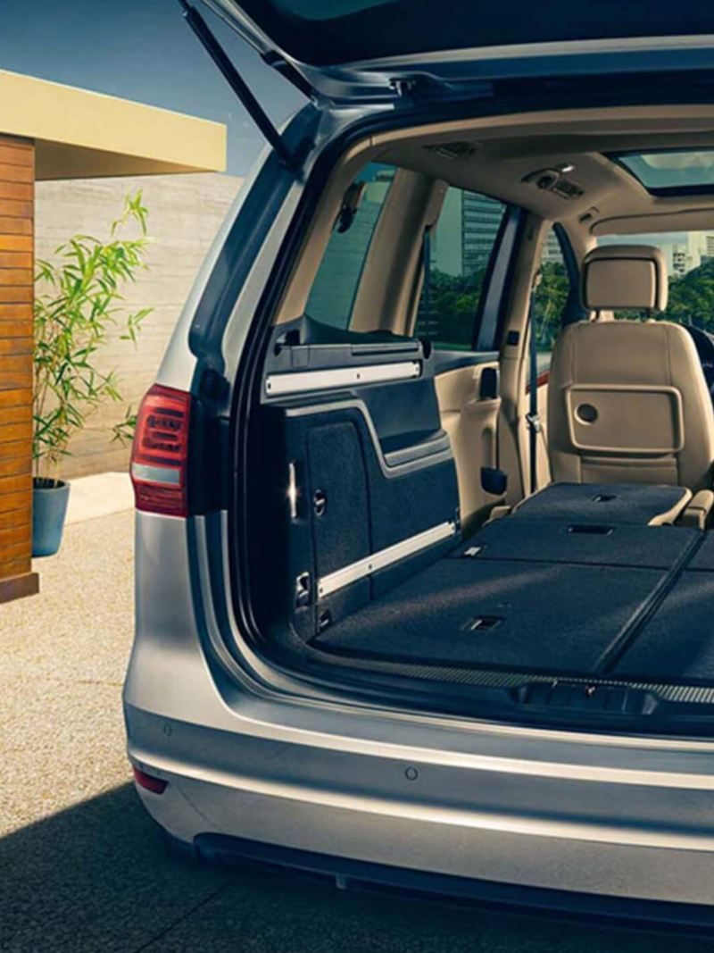 Boot open and passenger seats folded down, inside a Volkswagen Sharan.