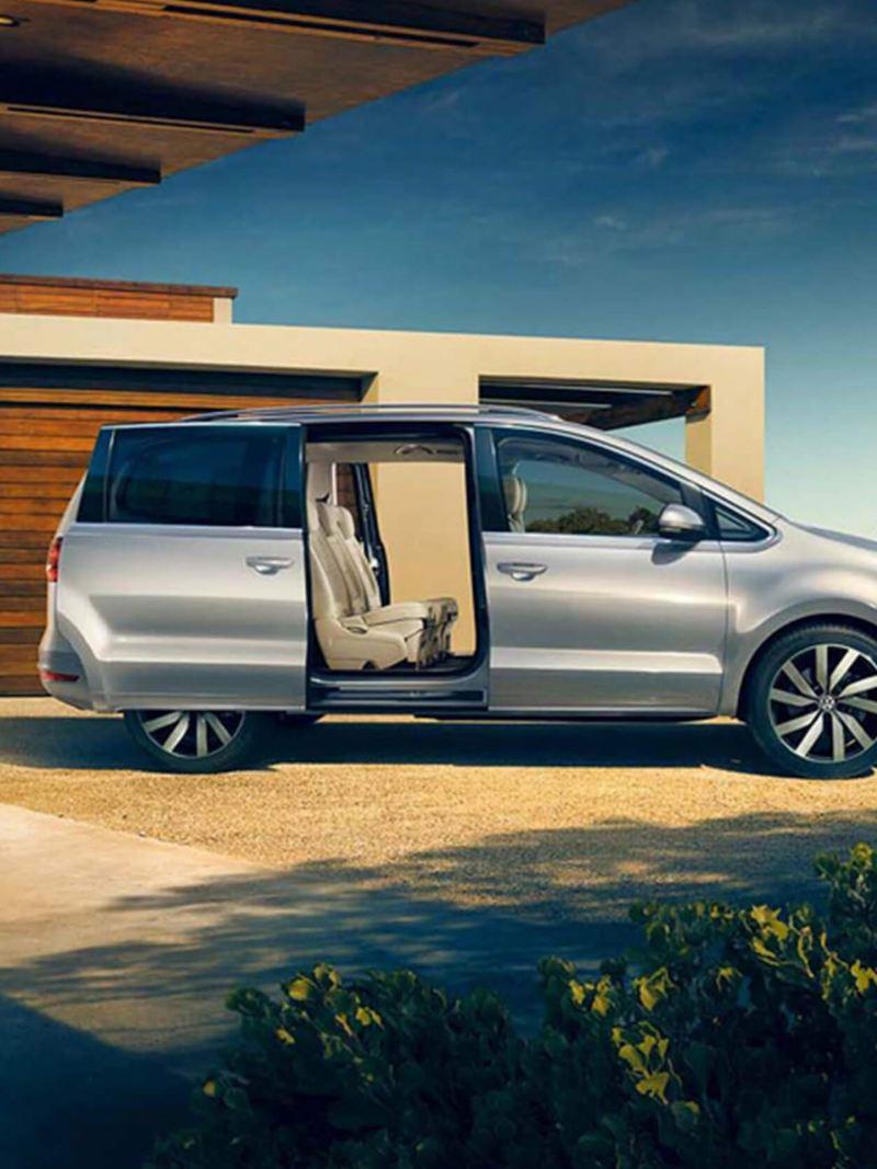 Profile shot of a silver Volkswagen Sharan, the side passenger door open.