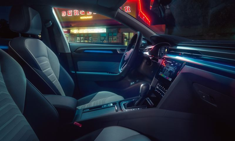 The interor of the Arteon shooting brake, showing the front seats and stylish dashboard.