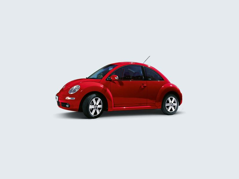 Profile shot of a red Volkswagen Beetle.