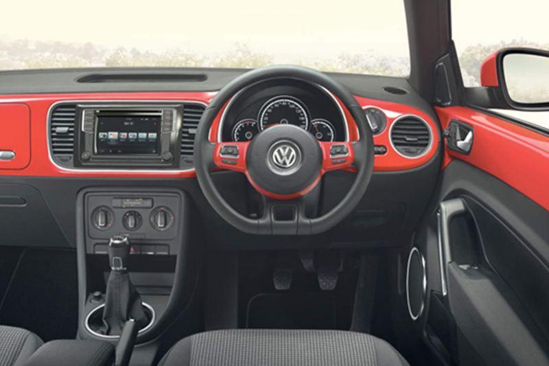 Dashboard and steering wheel shot of the Volkswagen Beetle.