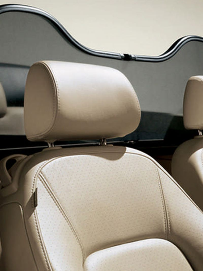 Interior shot of the front and rear seats of a Volkswagen Beetle Cabriolet.