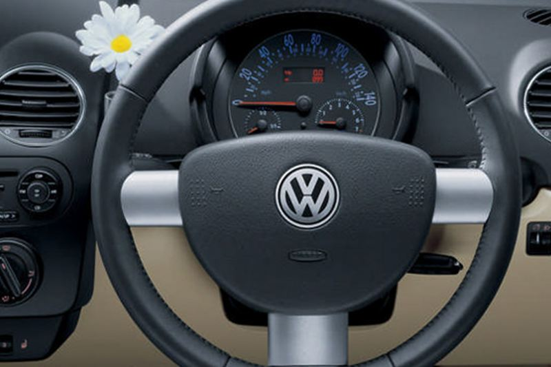 Interior shot of the Volkswagen Beetle Cabriolet, dash board and steering wheel