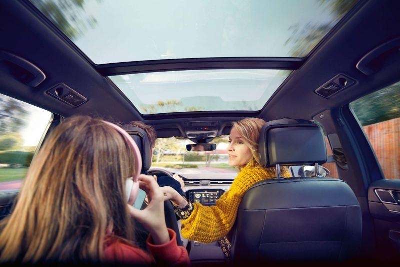Family sintting in their Volkswagen Passat Estate