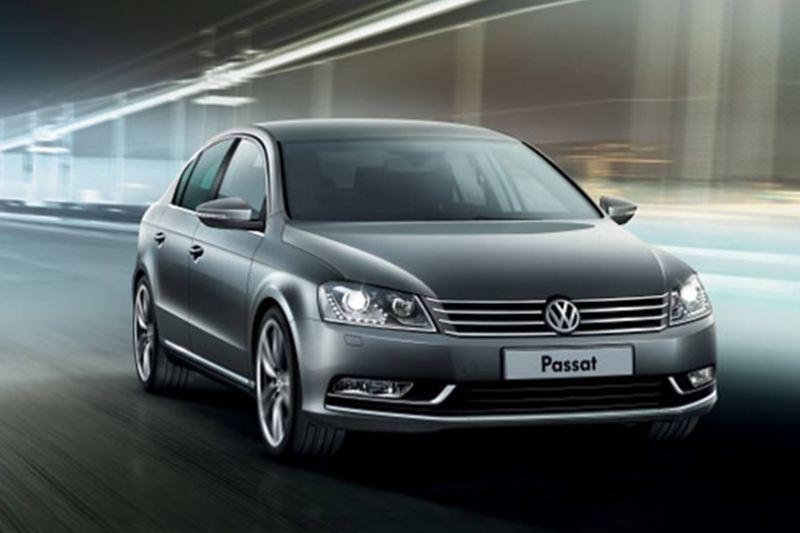 A grey Volkswagen Passat, driving through a tunnel.