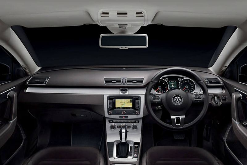 Interior shot of a Volkswagen Passat, steering wheel and dashboard.