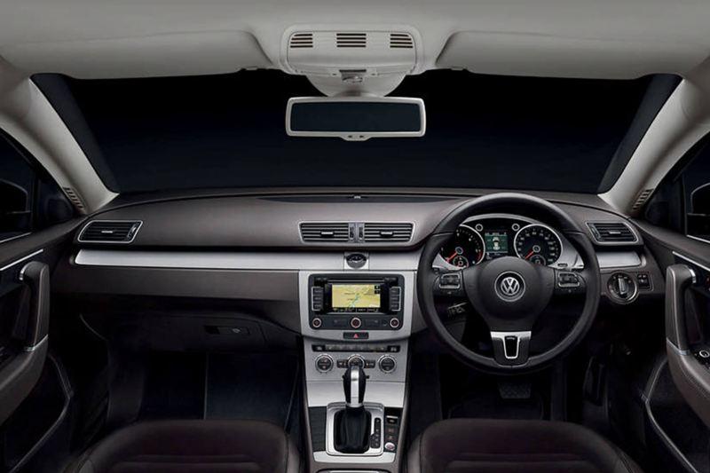 Interior shot of a Volkswagen Passat, steering wheel and dashboard.