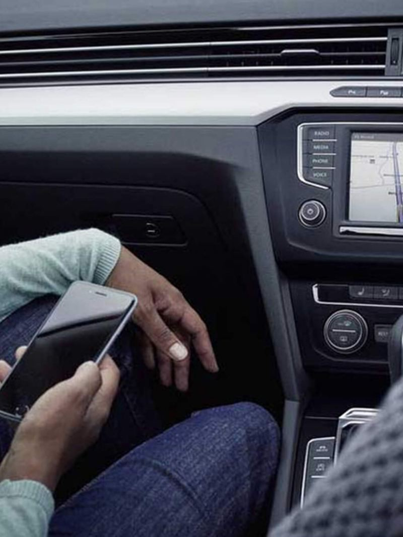 A man using the in-built sat-nav inside a Volkswagen Passat.