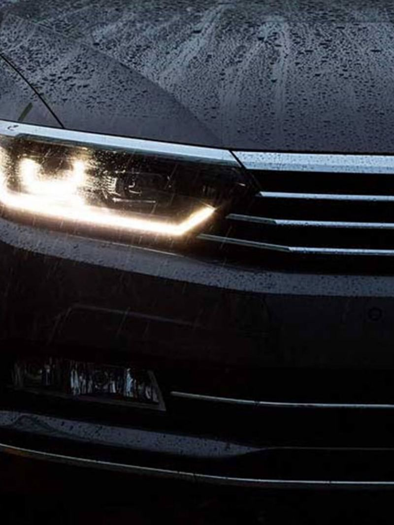 Front headlight shot of a black Volkswagen Passat.