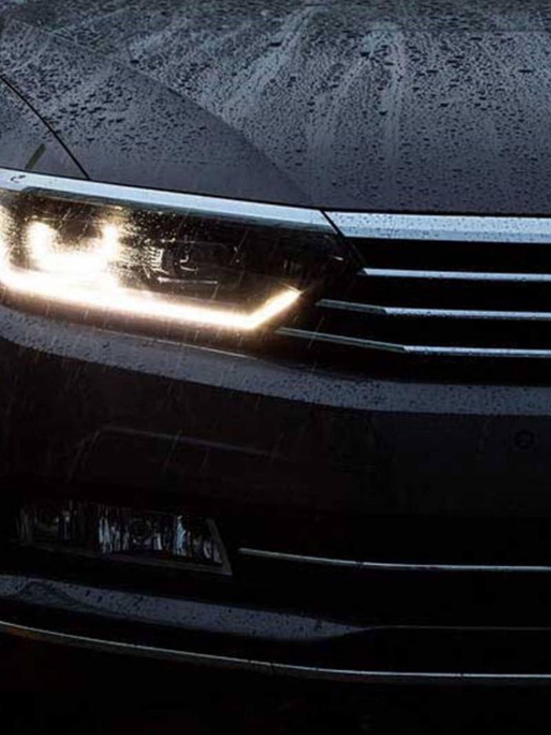 Front headlight shot of a black Volkswagen Passat.