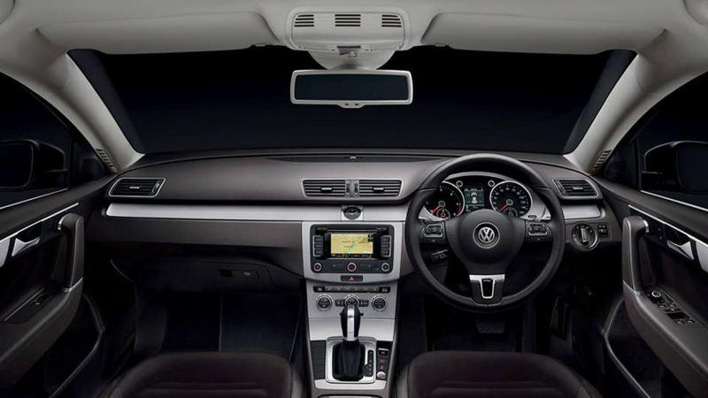 Interior shot of a Volkswagen Passat Estate, steering wheel and dashboard.