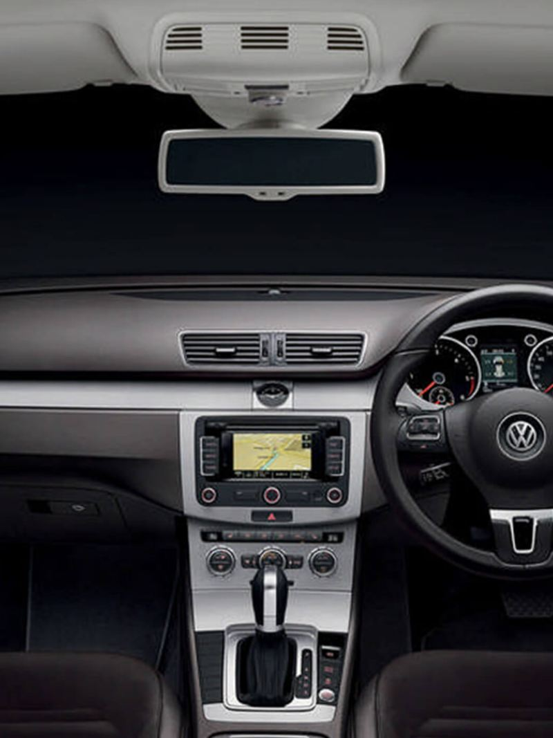 Interior shot of a Volkswagen Passat Estate, steering wheel and dashboard.