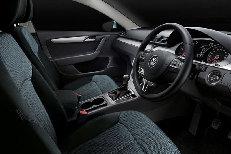 Interior shot of a Volkswagen Passar Estate, steering wheel and dashboard.