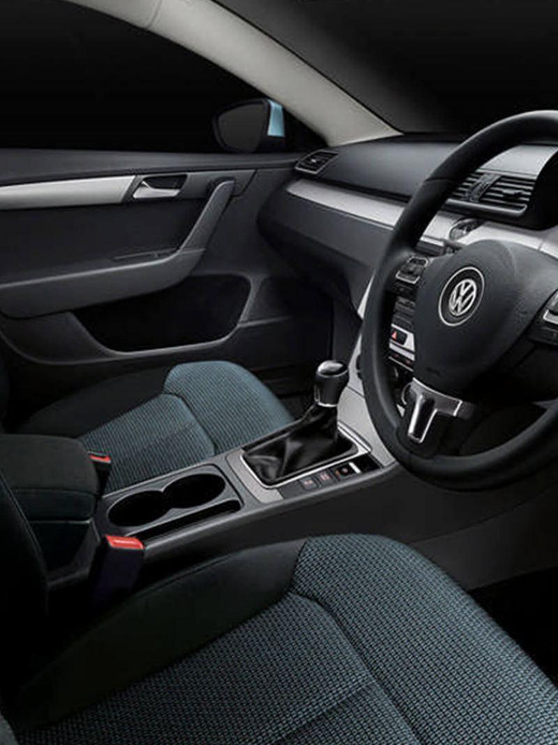 Interior shot of a Volkswagen Passar Estate, steering wheel and dashboard.