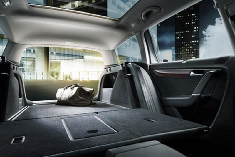 Interior shot a Volkswagen Passat, with the passenger seats folded down.