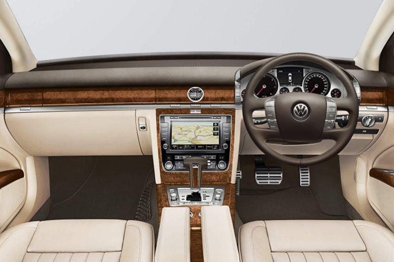 Interior shot of a Volkswagen Phaeton, steering wheel and dashboard.