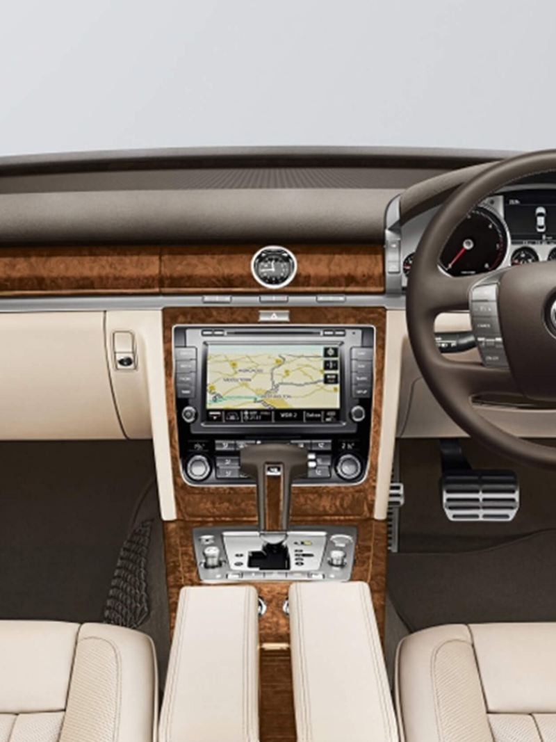 Interior shot of a Volkswagen Phaeton, steering wheel and dashboard.