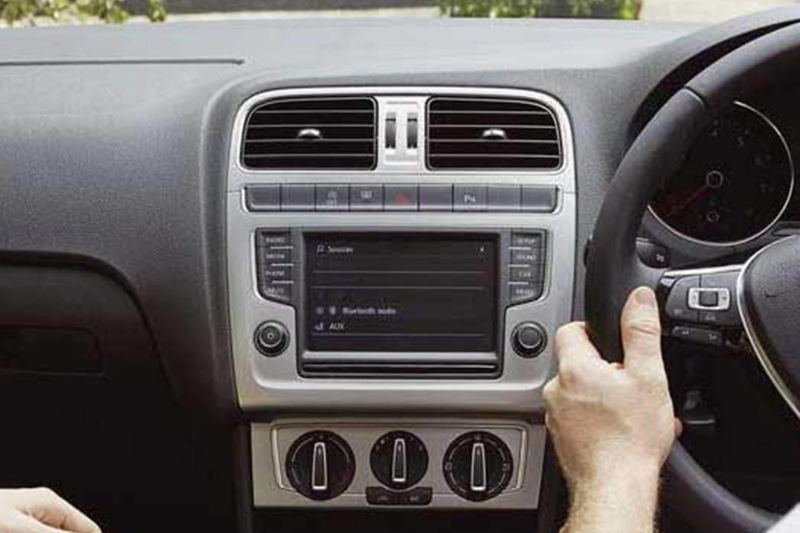 Interior shot of a Volkswagen Polof, steering wheel and dashboard.