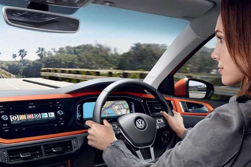 Interior shot of a Volkswagen Polo, steering wheel and dashboard.