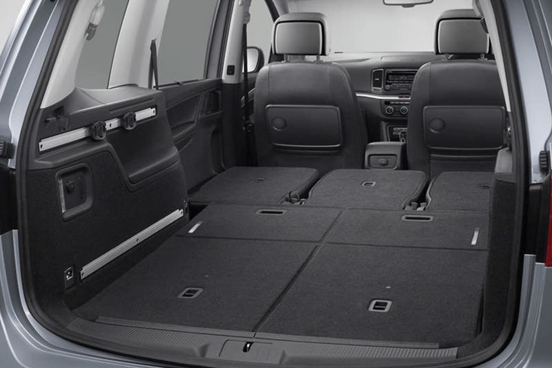 Open boot and folder passenger seats, inside a Volkswagen Sharan.