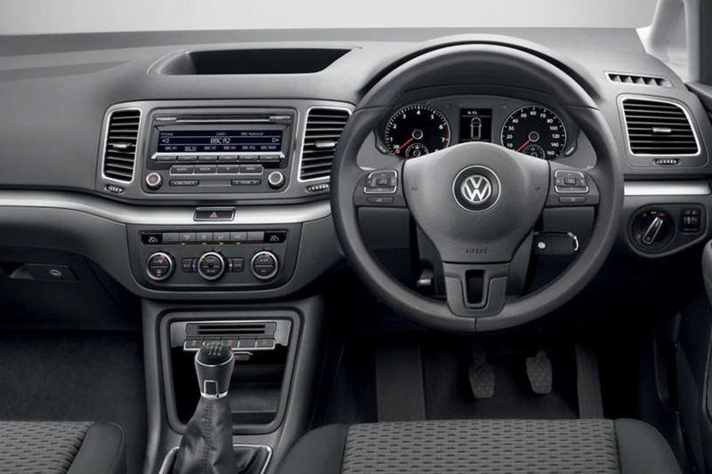 Interior shot of a Volkswagen Sharan, steering wheel and dashboard.