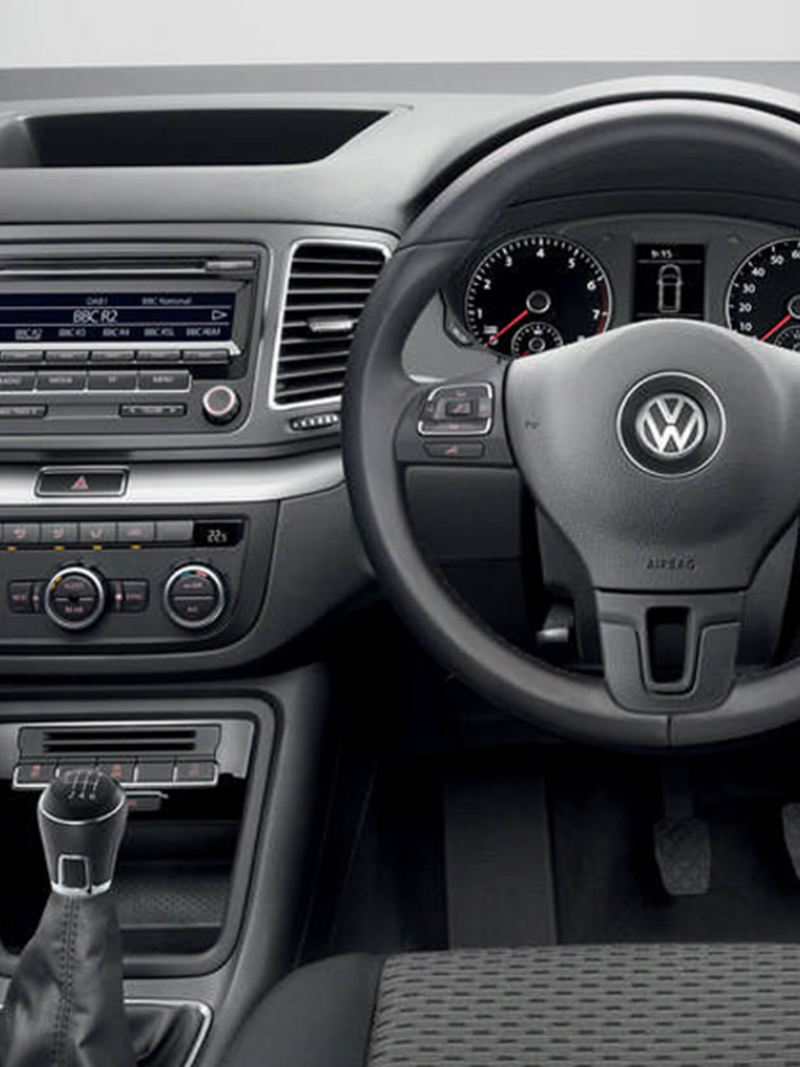 Interior shot of a Volkswagen Sharan, steering wheel and dashboard.