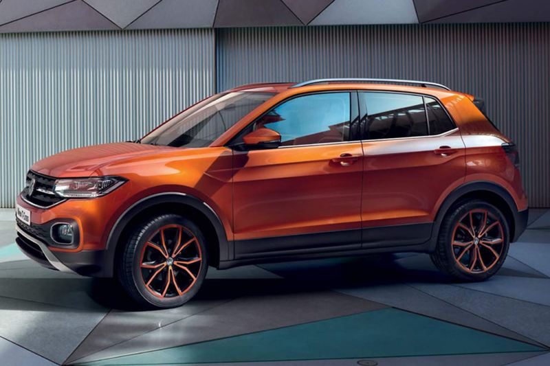 Profile shot of an orange Volkswagen T-Cross.