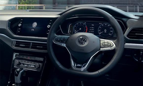 Interior shot of a Volkswagen T-Cross, steering wheel and dashboard.