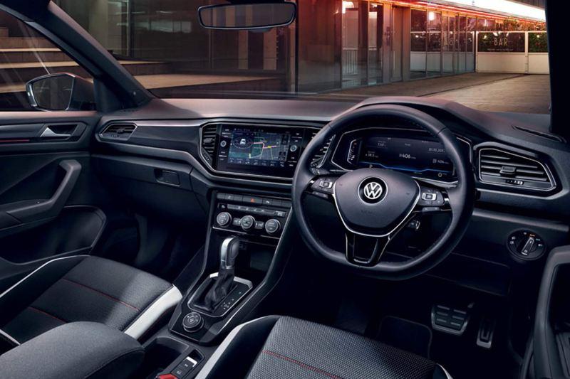 Interior shot of a Volkswagen T-Roc, steering wheel and dashboard.