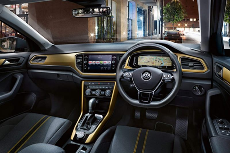 Interior shot of a Volkswagen T-Roc, steering wheel and dashboard.