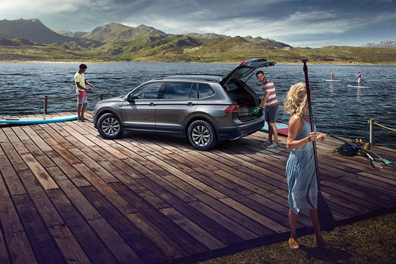Grey Volkswagen Tiguan Allspace on the deck of a boating lake.