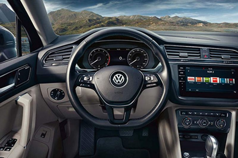 Interior shot of a Volkswagen Tiguan Allspace, steering wheel and dashboard.