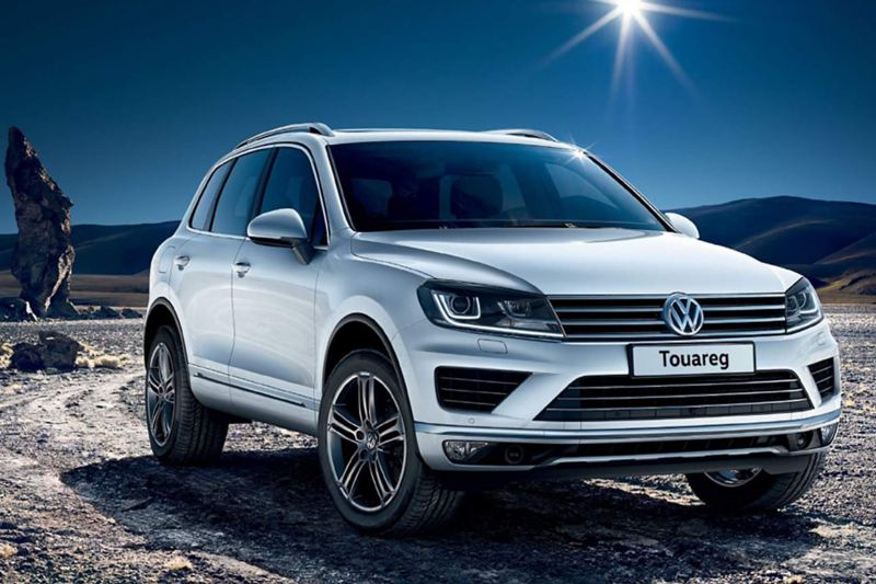 White Volkswagen Touareg, in the desert.