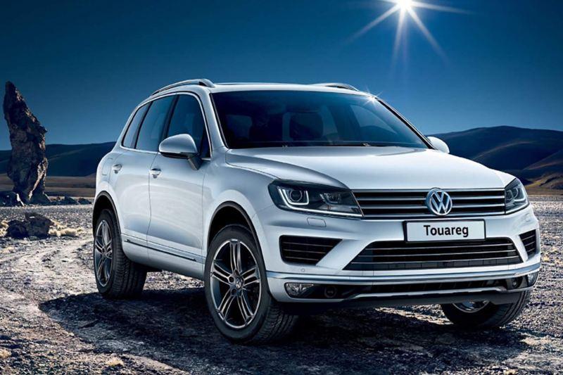 White Volkswagen Touareg, in the desert.