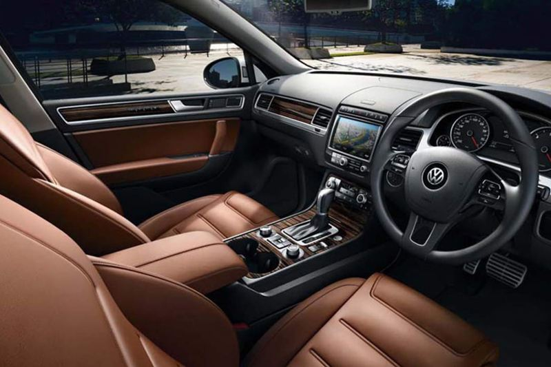 Interior shot of a Volkswagen Touareg, steering wheel and dashboard.