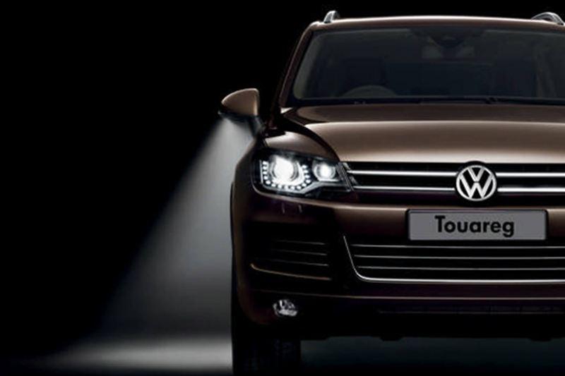 Bronze Volkswagen Touareg, headlight shot.