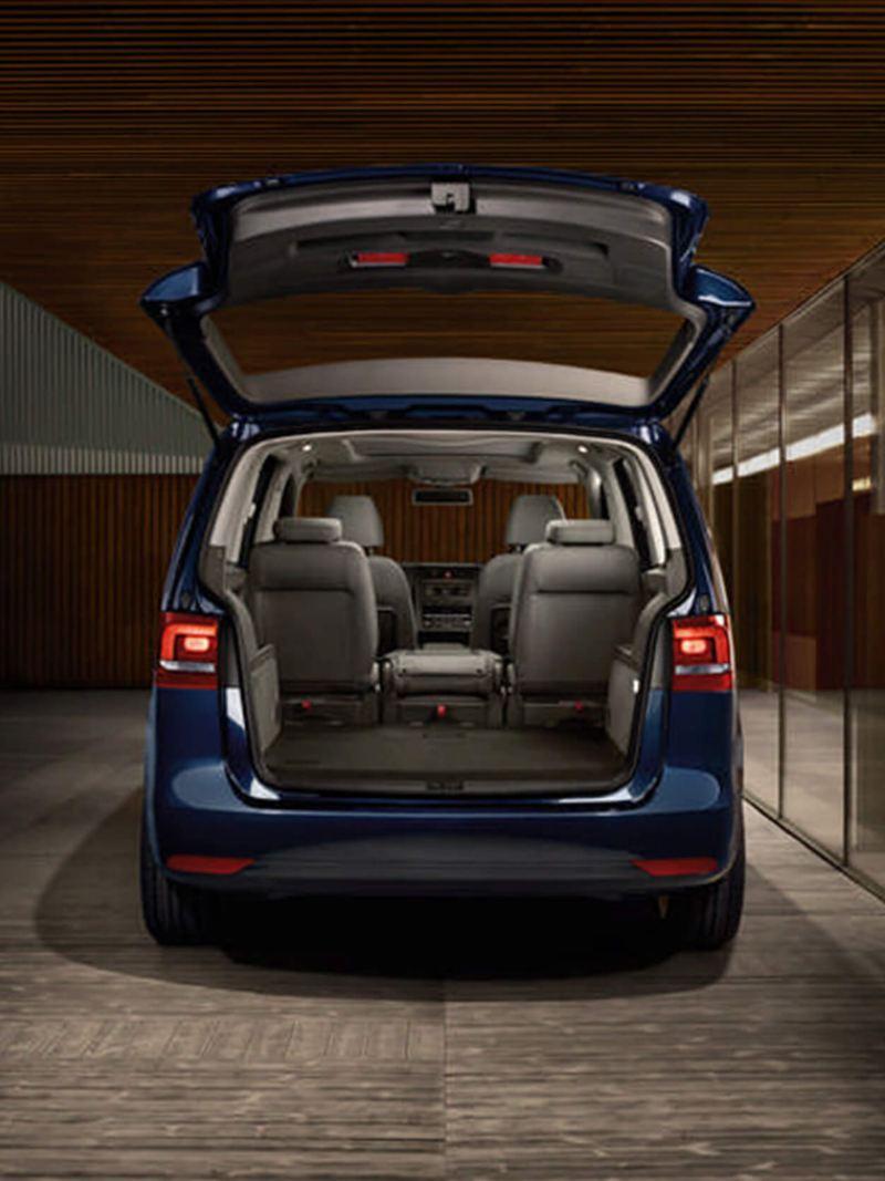 Open boot and passenger seats, inside a Volkswagen Touran.
