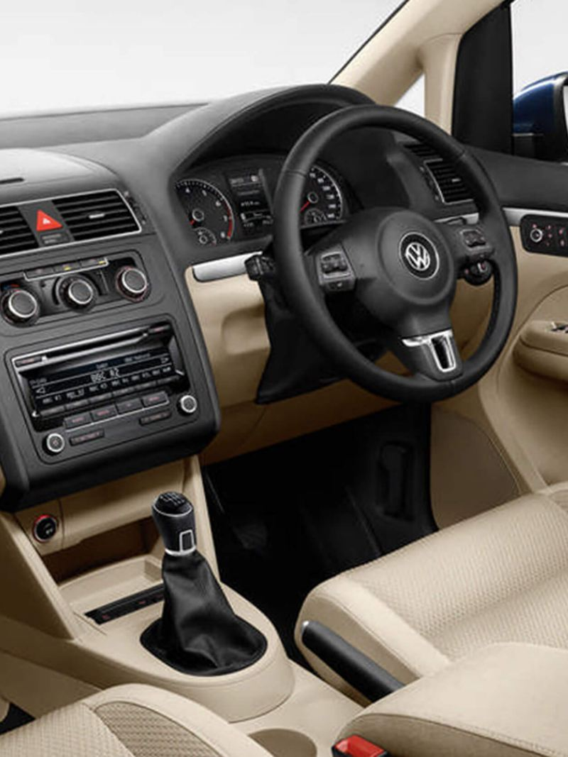 Interior shot of a Volkswagen Touran, steering wheel and dashboard.