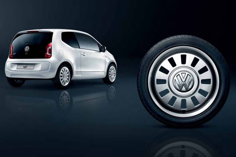 3/4 back view of a white Volkswagen up!.
