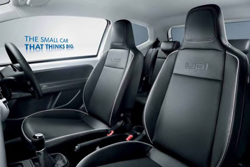 Interior shot of a Volkswagen up!, steering wheel and front seats.