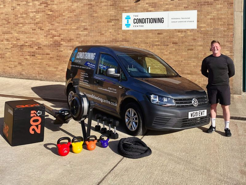 Joel Thomas of Conditioning Centre standing next to a Volkswagen Caddy