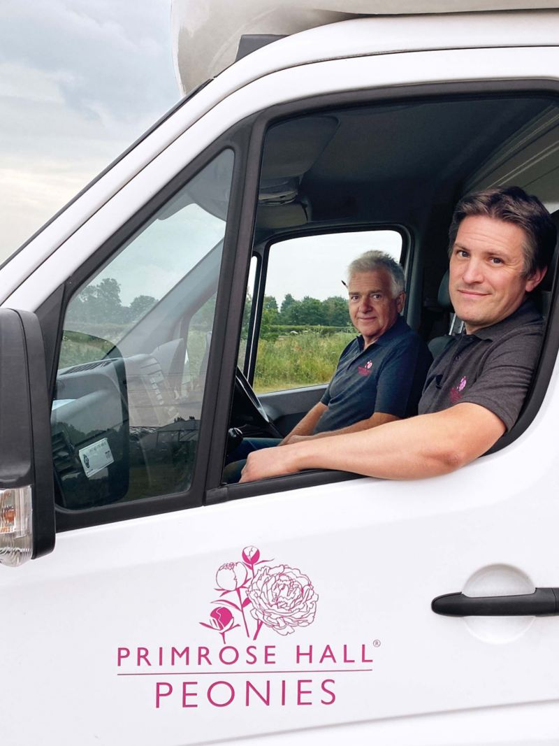 Primrose Hall inside the cab of their Volkswagen Crafter conversion