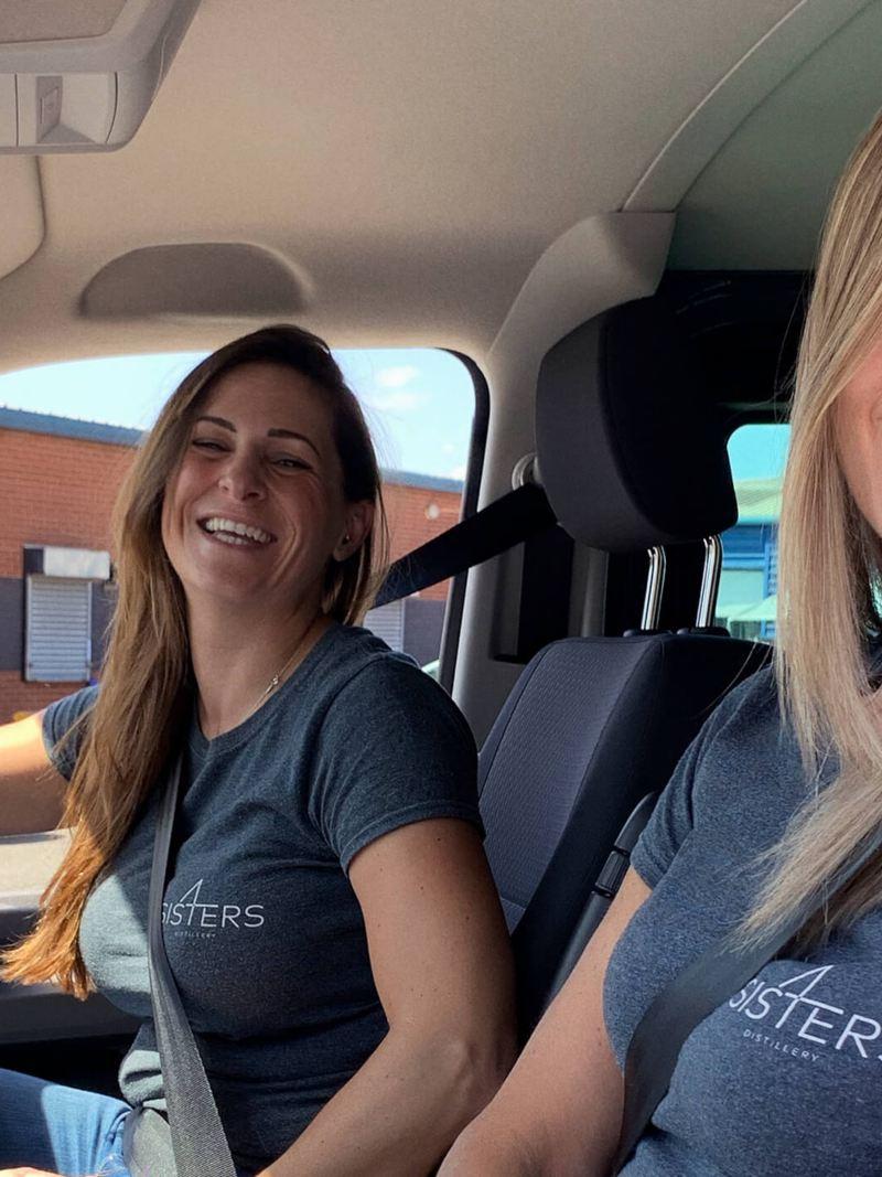 Employees of SIS4ERS DISTILLERY sat inside a Volkswagen van