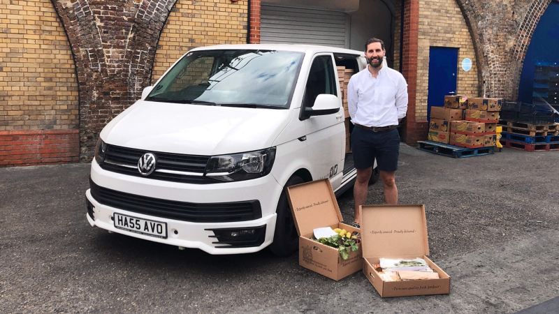 Nick, director of Smith & Brock standing next to a Volkswagen Transporter panel van