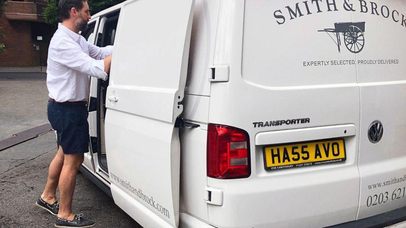 Nick, director of Smith & Brock loading a Volkswagen Transporter panel van